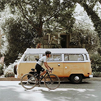 """man riding a bike on the residential streets of sacramento"""