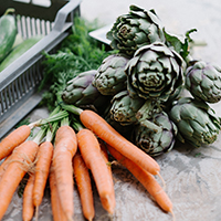 """image of fresh carrots and artichokes"